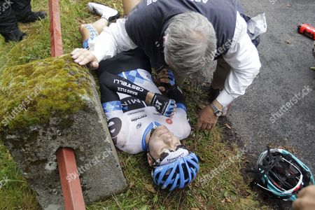 Garmin-cervelo Team Rider David Zabriskie of the Us is Attended to by a Medic After Suffering Injuries After a Crash During the 9th Stage of the Tour De France Cycling Race Between Issoire and Saint-flour France 10 July 2011 France Saint-flour