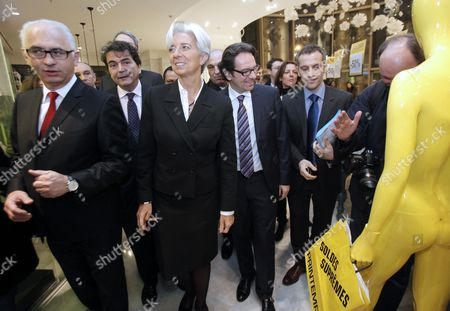 French Minister of Economy Christine Lagarde (c) French Junior Minister For Trade Small- and Medium-sized Businesses Tourism the Service Industry Independent Professions and Consumption Frederic Lefebvre (2-r) and Deputy Minister For Foreign Trade Pierre Lellouche (2-l) Are Seen As They Tour Paris' Printemps Department Store During Its Winter Sales Launch in Paris France 12 January 2011 France Paris