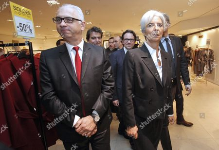French Minister of Economy Christine Lagarde (r) and French Junior Minister For Trade Small- and Medium-sized Businesses Tourism the Service Industry Independent Professions and Consumption Frederic Lefebvre (2-r) Are Seen As They Tour Paris' Printemps Department Store During Its Winter Sales Launch in Paris France 12 January 2011 France Paris