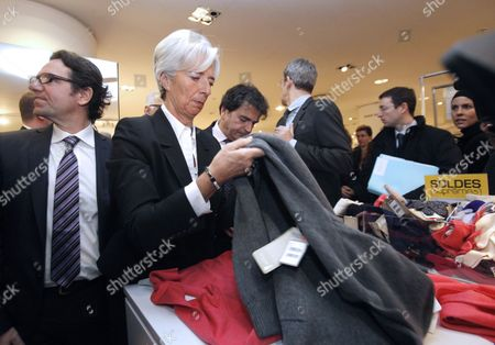 French Minister of Economy Christine Lagarde (r) Followed by French Junior Minister For Trade Small- and Medium-sized Businesses Tourism the Service Industry Independent Professions and Consumption Frederic Lefebvre (l) Look at the Clothes As They Tour Paris' Printemps Department Store During Its Winter Sales Launch in Paris France 12 January 2011 France Paris