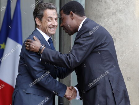 French President Nicolas Sarkozy (l) Greets Benin's President Thomas Yayi Boni (c) at the Elysee Palace in Paris France 13 July 2010 Before a Working Lunch with Several African Leaders Fourteen African Countries Will Be Honour Guest and Will Parade Beside the French Army on the Champs Elysees During the French Traditional Parade on 14 July 2010 France Paris