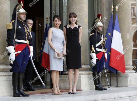 French First Lady Carla Bruni Sarkozy (r) Greets Gabonese First Lady Sylvia Bongo Ondimba (l) at the Elysee Palace in Paris France 13 July 2010 Before a Tea Reception with Several African Leaders Spouses Fourteen African Countries Will Be Honour Guest and Will Parade Beside the French Army on the Champs Elysees During the French Traditional Parade on 14 July 2010 France Paris