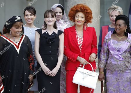 Familly Picture of the First Ladies From L-r Benin Chantal De Souza Yayi Gabonese Sylvia Bongo Ondimba French Carla Bruni Sarkozy Mauritanian Tekber Mint Melainine Ould Ahmed Cameroon Chantal Biya Senegalese Viviane Wade and Mali Lobbo Traore Toure at the Elysee Palace in Paris France 13 July 2010 After a Tea Reception with Several African Leaders Spouses Fourteen African Countries Will Be Honour Guest and Will Parade Beside the French Army on the Champs Elysees During the French Traditional Parade on 14 July 2010 France Paris