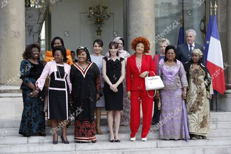 Familly Picture of the First Ladies (ltor) Central African Republic Monique Bozize Benin Chantal De Souza Yayi Congolese Antoinette Sassou Nguesso Burkina Faso Chantal Compaore Gabonese Sylvia Bongo Ondimba French Carla Bruni Sarkozy Mauritanian Tekber Mint Melainine Ould Ahmed Cameroon Chantal Biya Senegalese Viviane Wade Mali Lobbo Traore Toure Director of Funds Against Aids Michel Kazatchkine and Niger Fati Alzouma Djibo Salou at the Elysee Palace in Paris France 13 July 2010 After a Tea Reception with Several African Leaders Spouses Fourteen African Countries Will Be Honour Guest and Will Parade Beside the French Army on the Champs Elysees During the French Traditional Parade on 14 July 2010 France Paris