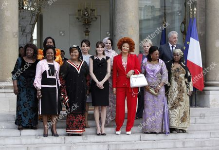 Familly Picture of the First Ladies From L-r Central African Republic Monique Bozize Benin Chantal De Souza Yayi Congolese Antoinette Sassou Nguesso Burkina Faso Chantal Compaore Gabonese Sylvia Bongo Ondimba French Carla Bruni Sarkozy Mauritanian Tekber Mint Melainine Ould Ahmed Cameroon Chantal Biya Senegalese Viviane Wade Mali Lobbo Traore Toure Director of Funds Against Aids Michel Kazatchkine and Niger Fati Alzouma Djibo Salou at the Elysee Palace in Paris France 13 July 2010 After a Tea Reception with Several African Leaders Spouses Fourteen African Countries Will Be Honour Guest and Will Parade Beside the French Army on the Champs Elysees During the French Traditional Parade on 14 July 2010 France Paris