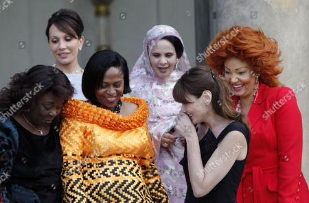 Familly Picture of the First Ladies From L-r Central African Republic Monique Bozize Benin Chantal De Souza Yayi Gabonese Sylvia Bongo Ondimba French Carla Bruni Sarkozy Mauritanian Tekber Mint Melainine Ould Ahmed and Cameroon Chantal Biya at the Elysee Palace in Paris France 13 July 2010 After a Tea Reception with Several African Leaders Spouses Fourteen African Countries Will Be Honour Guest and Will Parade Beside the French Army on the Champs Elysees During the French Traditional Parade on 14 July 2010 France Paris