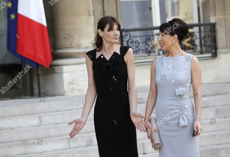 Gabonese First Lady Sylvia Bongo Ondimba (r) Chats with French Carla Bruni Sarkozy (l) at the Elysee Palace in Paris France 13 July 2010 After a Tea Reception with Several African Leaders Spouses Fourteen African Countries Will Be Honour Guest and Will Parade Beside the French Army on the Champs Elysees During the French Traditional Parade on 14 July 2010 France Paris