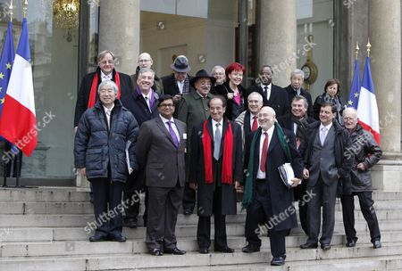 International Economists (first Row From L) China's Yu Yongding Barbados' Avinash Persaud France's Jean-paul Fitoussi Us Nobel Prize Laureate Joseph Stiglitz and Ecuador's Perez Pedro Paez (2nd Row From L) Us Robert Johnson Italy's Marcello De Cecco British Lord Nicholas Stern French Francois Bourguignon (man Far Right is Unidentified) (3rd Row From L) Russia's Andrei Bougrov England's Tim Besley Unidentified Colombia's Jose Antonio Ocampo Germany's Heidemarie Wieczorek-zeul Uganda's Louis Kasekende Japan's Eisuke Sakakibara and Malaysian Central Bank Governor Akhtdar Aziz Zeti Leave the Elysee Palace in Paris France 06 January 2011 After a Working Lunch with French President Nicolas Sarkozy and International Economists to Prepare the G20 Meeting French President Has Set As G20 Priorities a Major Overhaul of the Global Economy's Infrastructure Including a Reforming the Monetary System and Ending Excessive Price Swings in Commodity Markets As Well As Improving Economic Governance France Paris