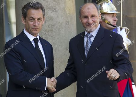 French President Nicolas Sarkozy (l) Greets President of Libyan Council of National Transition (cnt) Mustafa Abdel Jalil at the Elysee Palace in Paris France 20 April 2011 Abdeljalil Met Sarkozy in a Bid to Maintain Diplomatic Momentum in the Absence of Military Progress in the Insurgents Campaign Against Libya's Leader Colonel Muammar Gaddafi France Paris