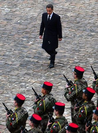 French President Nicolas Sarkozy Reviews Troops After Paying His Respects to Former French Politician and President of the 'Cour Des Comptes' (france's Public Finance Watchdog Committee) Philippe Seguin (pictured in the Poster) During the Funeral Ceremony at Invalides in Paris France 11 January 2010 Seguin an Influential and Eurosceptic French Politician Died of a Heart Attack on 07 January 2010 Aged 66 France Paris