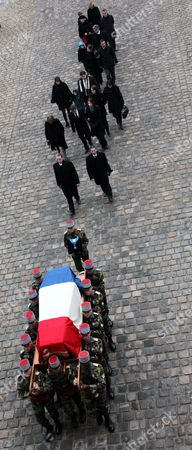 French President Nicolas Sarkozy and His Wife Carla Bruni-sarkozy and Members of the Seguin Family Follow the Coffin of Former French Politician and President of the 'Cour Des Comptes' (france's Public Finance Watchdog Committee) Philippe Seguin (pictured in the Poster) During the Funeral Ceremony at Invalides in Paris France 11 January 2010 Seguin an Influential and Eurosceptic French Politician Died of a Heart Attack on 07 January 2010 Aged 66 France Paris