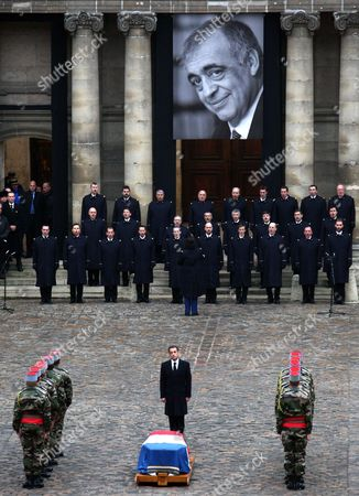 French President Nicolas Sarkozy Pays His Respects in Front of the Coffin of Former French Politician and President of the 'Cour Des Comptes' (france's Public Finance Watchdog Committee) Philippe Seguin (pictured on the Poster) During the Funeral Ceremony at Invalides in Paris France 11 January 2010 Seguin an Influential and Eurosceptic French Politician Died of a Heart Attack on 07 January 2010 Aged 66 France Paris