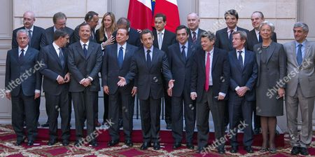 French President Nicolas Sarkozy (c) Italian Prime Minister Silvio Berlusconi (center-l) and Ministers of Both French and Italian Governments Pose For a Group Photo at the Elysee Palace in Paris France 09 April 2010 Italian Prime Minister Silvio Berlusconi Arrived in France For a Franco-italian Summit Pictured Are (front Row L-r): Italian Minister For Economic Development Claudio Scajola Italian Defense Minister Ignazio La Russa Italian Foreign Minister Franco Frattini Italian Premier Silvio Berlusconi French President Nicolas Sarkozy French Premier Francois Fillon French Minister For Ecology Jean Louis Borloo French Foreign Minister Bernard Kouchner French Finance Minister Christine Lagarde and French Defense Minister Herve Morin (back Row L-r) Italian Culture Minister Sandro Bondi Italian Minister of Economy Giulio Tremonti Unidentified Italian Environment Minister Stefania Prestigiacomo Italian Minister For European Policies Andrea Ronchi Unidentified Eric Besson French Minister For Immigration Dominique Bussereau French Minister For Energy French Secretary of State For European Affairs Pierre Lellouche French Minister of Culture Frederic Mitterrand France Paris