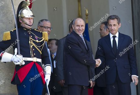 French President Nicolas Sarkozy (r) Escorts President of Libyan Council of National Transition (cnt) Mustafa Abdeljalil (l) As He Leaves the Elysee Palace in Paris France 20 April 2011 Abdeljalil Met Sarkozy in a Bid to Maintain Diplomatic Momentum in the Absence of Military Progress in the Insurgents' Campaign Against Libya's Leader Colonel Muammar Gaddafi France Paris