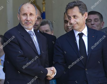 Stock Photo of French President Nicolas Sarkozy (r) Escorts President of Libyan Council of National Transition (cnt) Mustafa Abdeljalil (l) As He Leaves the Elysee Palace in Paris France 20 April 2011 Abdeljalil Met Sarkozy in a Bid to Maintain Diplomatic Momentum in the Absence of Military Progress in the Insurgents' Campaign Against Libya's Leader Colonel Muammar Gaddafi France Paris