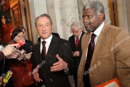 Stock Image of Paris Mayor Bertrand Delanoe (l) Adresses the Media with Haitian Mayor of Port Au Prince Jean Yves Jason (r) at the Hotel De Ville in Paris France 23 February 2010 Delanoe Announced 1 5 Million Euros in Aid For Rebuilding the City of Port Au Prince Which was Devastated in the Magnitude 7 Earthquake That Hit Haiti on 12 January 2010 France Paris