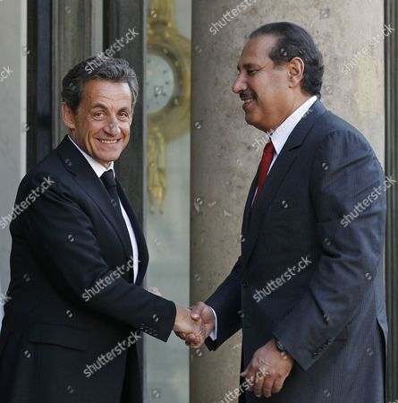 Stock Picture of French President Nicolas Sarkozy (l) Greets Qatari Prime Minister Sheikh Hamad Bin Jassim Bin Jaber Bin Muhammad Al Thani (r) at the Elysee Palace in Paris France 05 May 2011 Both Dignitaries Meet to Discuss Bilateral and Regional Issues France Paris
