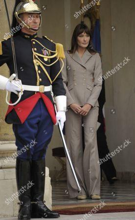 French First Lady Carla Bruni Sarkozy Waits to Greet Princess Victoria of Sweden and Her Husband Prince Daniel at Elysee Palace in Paris France 28 September 2010 on the Third Day of the Royal Couple's Official Visit to France Crown Princess Victoria and Prince Daniel Westling Are on a Four-day Official Visit in France France Paris