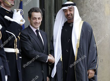 French President Nicolas Sarkozy (r) Greets United Arab Emirates' Crown Prince Mohammed Bin Zayed Al Nahyan (l) at the Elysee Palace in Paris France 15 December 2010 President Nicolas Sarkozy Recieves Uae General Sheikh Saif Bin Zayed Al Nahyan For a Working Lunch in Order to Discuss Regional and Middle East Affairs France Paris