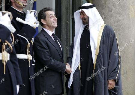 French President Nicolas Sarkozy (l) Greets United Arab Emirates' Crown Prince Mohammed Bin Zayed Al Nahyan (r) at the Elysee Palace in Paris France 15 December 2010 President Nicolas Sarkozy Recieves Uae General Sheikh Saif Bin Zayed Al Nahyan For a Working Lunch in Order to Discuss Regional and Middle East Affairs France Paris