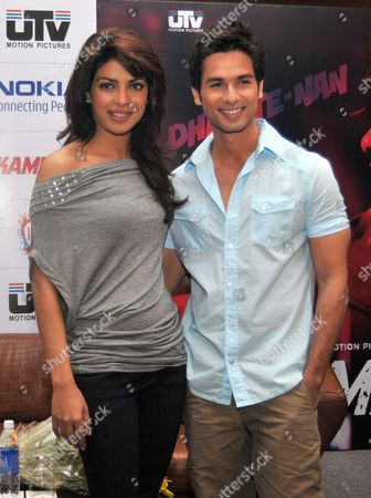Bollywood Actress Priyanka Chopra (l) and Bollywood Actor Shahid Kapoor (r) Pose For Photographs During a Promotional Event For Their New Movie 'Kaminey' Directed by Vishal Bhardwaj in the Southern Indian City of Bangalore 12 August 2009 India Bangalore