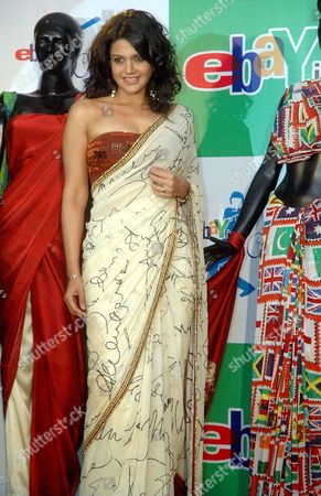 Indian Cricket Anchor and Television Star Mandira Bedi Posing with Exclusive World Cup 2007 Themed Saris in New Delhi 23 February 2007 E-bay India Will Auction Collectible Items As Part of Their E-bay Cricket Mania Support to the Indian Cricket Team For the Next Month's Cricket World Cup India New Delhi