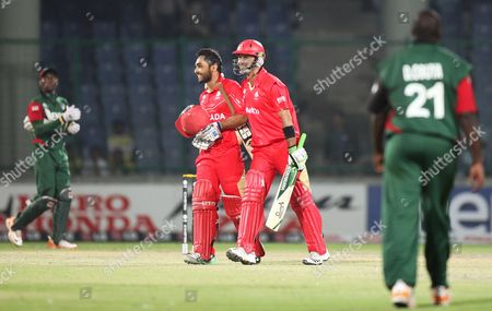 Canadian Cricketers Ashish Bagai (2nd L) and John Davison (2nd R) Celebrate Their Team's Victory Against Kenya During the Icc Cricket World Cup 2011 Match Between Kenya and Canada in New Delhi India 07 March 2011 Canada Beat Kenya by 5 Wickets India New Delhi