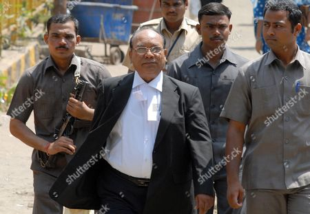 Stock Picture of K P Pawar (c) Lawyer of Prime Accused Mohammed Ajmal Amir Kasab Arrives at the Arthur Road Prison where the 2008 Mumbai Attacks Trial is Being Held in Mumbai India 06 May 2010 Pakistani National Ajmal Amir Kasab the Lone Gunman Captured Alive During the Mumbai Terror Attack was Sentenced to Death by a Special Court Which Ruled That He Did not Have Any Right to Live He Has Been Given Death on Four Counts Including Waging War Against India Murder and Indulging in Terrorist Activities India Mumbai