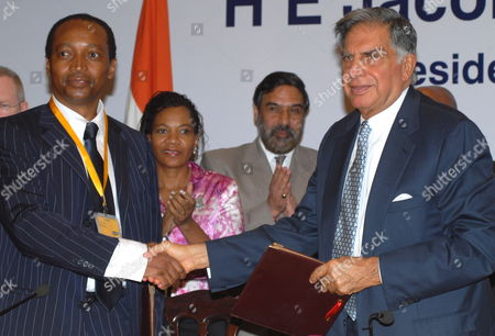 Patrice Motsepe (l) Chairman African Rainbow Minerals South Africa and Ratan Tata (r) Chairman Tata Group Shake Hands During an Event Organized by the Confederation of Indian Industry (cii) in Mumbai India 03 June 2010 the South African President is in India on a 3-day State Visit with a High-level Delegation Consisting of 100 Ceos and Eight Cabinet Ministers to Strengthen Bilateral Ties Between the Two Nations India Mumbai