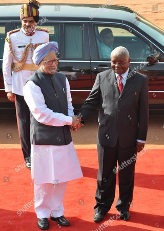 President of the Republic of Mozambique Armando Emilio Guebuza (r) Shakes Hand with Indian Prime Minister Manmohan Singh (l) Before a Welcoming Ceremony at the Presidential Palace in New Delhi India on 30 September 2010 President Armando Emilio Guebuza is on a Four Day Official Visit to India India New Delhi