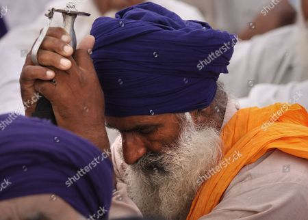 A Sikh Man Sits Holding His Sword As He Takes Part in a Remembrance and Prayer Meet For the Innocent People and Sikh Separatists who Lost Their Lives During the Operation Blue Star in the Year 1984 on the Occasion of the Operation's 27th Anniversary at the Golden Temple Premises in the Northern Indian City of Amritsar 06 June 2011 Special Prayers Were Held on the Occasion to Commemorate the Memory of Infamous Operation Blue Star During the Operation Blue Star the Indian Army Stormed Inside the Golden Temple to Flush out Militants Hiding There and to Arrest Sant Jarnail Singh Bhindranwale a Sikh Leader and His Militant Followers who Had Initiated a Movement For a Separate Sikh State Named As 'Khalistan' India Amritsar