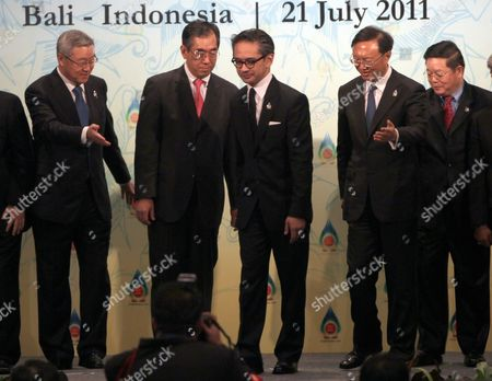Asean Plus Three Foreign Ministers Walk After a Photo Session Before Meeting at Nusa Dua Bali Indonesia 21 July 2011 Indonesia Host the 44th Asean Ministerial Meeting (amm) Post Ministerial Conference (pmc) and 18th Asean Regional Forum (arf) From 19 to 23 July (from R-l) Cambodia's Secretary of State Kao Kim Hourn China's Foreign Minister Yang Jiechi Indonesian Foreign Minister Marty Natalegawa Japan Foreign Minister Takeaki Matsumoto and South Korean Foreign Affair and Trade Kim Sung-hwan Indonesia Nusa Dua