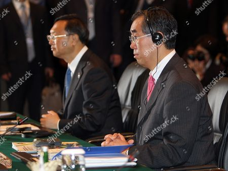 China's Foreign Minister Yang Jiechi (l) and Japan's Foreign Minister Takeaki Matsumoto (r) Sit During Asean Plus Three Foreign Ministers Meeting at Nusa Dua Bali Indonesia 21 July 2011 Indonesia Host the 44th Asean Ministerial Meeting (amm) Post Ministerial Conference (pmc) and 18th Asean Regional Forum (arf) From 19 to 23 July Indonesia Nusa Dua