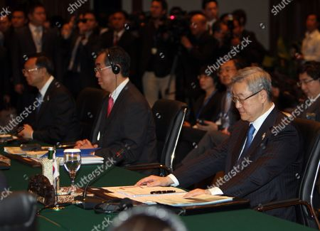 China's Foreign Minister Yang Jiechi (l) Japan Foreign Minister Takeaki Matsumoto (c) and South Korean Foreign Minister and Trade Kim Sung-hwan (r) Sit During Asean Plus Three Foreign Ministers Meeting at Nusa Dua Bali Indonesia 21 July 2011 Indonesia Host the 44th Asean Ministerial Meeting (amm) Post Ministerial Conference (pmc) and 18th Asean Regional Forum (arf) From 19 to 23 July Indonesia Nusa Dua
