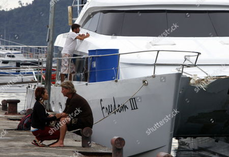 Tsunami Survivor who Also the Captain of Crashed Boat 'Midas' Australian Richard Hope (r) Talks to His Wife As He Arrives at a Seaport Two Days After a Tsunami Hit His Boat in Padang West Padang Indonesia 27 October 2010 Hope and Nine Australian Surfers and Dozens Crews Survived As They Held on to Surfboards and Other Materials After a 10-foot Tsunami Hit Two Boats and Sunk One of Them a 7 7 Magnitude Earthquake-triggered Tsunami Hit Mentawai Island and Swept Away Homes Killing at Least 113 People and Leaving 502 Missing Indonesia Jakarta