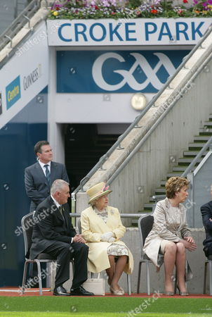 Britain's Queen Elizabeth Ii (c) and Irish President Mary Mcaleese (r) and Gaa (gaelic Athletic Association) President Christy Cooney (l) Sit at Croke Park in Dublin Ireland 18 May 2011 Queen Elizabeth Arrived on 17 May in Ireland For an Historic Four-day State Visit the First by a British Monarch Since Irish Independence Ireland Dublin