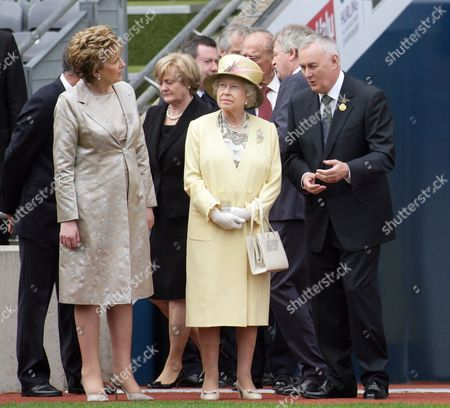 Britain's Queen Elizabeth Ii (c) and Irish President Mary Mcaleese (l) Listen to Gaa (gaelic Athletic Association) President Christy Cooney (r) at Croke Park in Dublin Ireland 18 May 2011 Queen Elizabeth Arrived on 17 May in Ireland For an Historic Four-day State Visit the First by a British Monarch Since Irish Independence Ireland Dublin