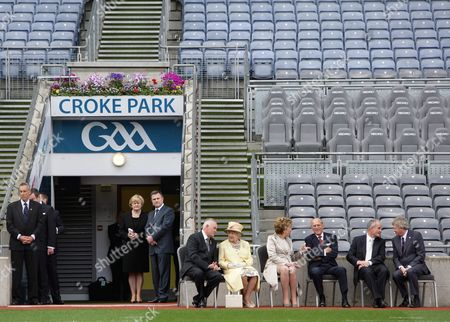 Britain's Queen Elizabeth Ii (c) and Irish President Mary Mcaleese (c-r) Listen to Gaa (gaelic Athletic Association) President Christy Cooney (c-l) at Croke Park in Dublin Ireland 18 May 2011 Queen Elizabeth Arrived on 17 May in Ireland For an Historic Four-day State Visit the First by a British Monarch Since Irish Independence Ireland Dublin