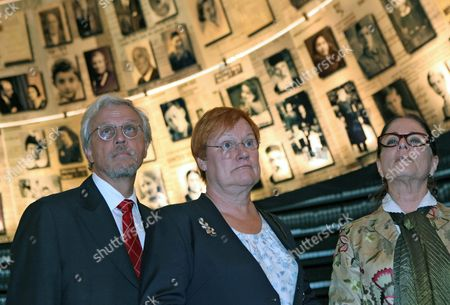 Finland's President Tarja Halonen (c) As She Views with Her Husband Pentti Arajarvi (l) and a Museum Curator the 'Hall of Names' in the Yad Vashem Holocaust Memorial Museum in Jerusalem on 12 October 2010 the Uniquely Shaped Room Contains 600 Portraits of Individual Jews who Perished in the Holocaust of World War Ii Israel Jerusalem