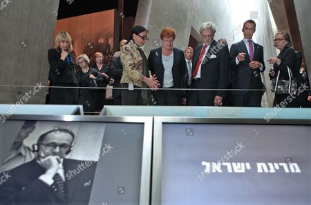 Finland's President Tarja Halonen (c-r) Listens to a Curator Explain a Display As She Tours the Yad Vashem Holocaust Memorial Museum in Jerusalem on 12 October 2010 Next to Her is Her Husband Pentti Arajarvi and the Foreign Minister Alexander Stubb (2-r) in Front is an Exhibit on the Trial in Israel of Adolf Eichmann the Only Person Israel Has Ever Executed For War Crimes Israel Jerusalem