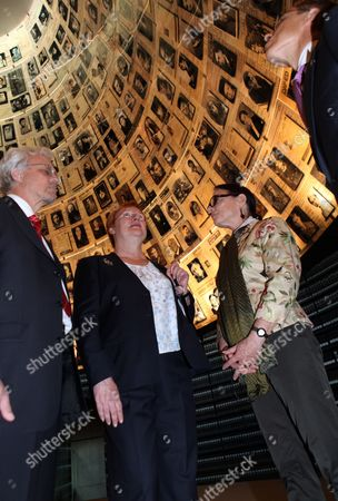 Finland's President Tarja Halonen (c) As She Views with Her Husband Pentti Arajarvi (l) Finnish Foriegn Minister Alexander Stubb (r) and a Museum Curator the 'Hall of Names' in the Yad Vashem Holocaust Memorial Museum in Jerusalem on 12 October 2010 the Uniquely Shaped Room Contains 600 Portraits of Individual Jews who Perished in the Holocaust of World War Ii Israel Jerusalem