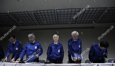 Tokyo Electric Power Co Chairman Tsunehisa Katsumata (c) Stands with Company's Executives at the End of a News Conference Held at the Company Headquarters in Tokyo Japan 30 March 2011 Katsumata Said It Will More Than a Few Weeks to Fix the Fukushima Daiichi Nuclear Power Plant Earlier in the Day Tepco Announced That Its President Masataka Shimizu was Hospitalized on 29 March For Hypertension Katsumata is Taking Over Shimizu's Position to Lead Efforts to Control the Crisis Japan Tokyo