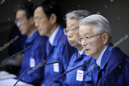 Sitting with Company's Executives Tokyo Electric Power Co Chairman Tsunehisa Katsumata (r) Speaks During a News Conference in Tokyo Japan 30 March 2011 Katsumata Said It Will More Than a Few Weeks to Fix the Fukushima Daiichi Nuclear Power Plant Earlier in the Day Tepco Announced That Its President Masataka Shimizu was Hospitalized on 29 March For Hypertension Katsumata is Taking Over Shimizu's Position to Lead Efforts to Control the Crisis Japan Tokyo