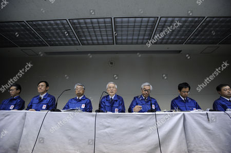 Sitting with Company's Executives Tokyo Electric Power Co Chairman Tsunehisa Katsumata (c) Speaks During a News Conference in Tokyo Japan 30 March 2011 Katsumata Said It Will More Than a Few Weeks to Fix the Fukushima Daiichi Nuclear Power Plant Earlier in the Day Tepco Announced That Its President Masataka Shimizu was Hospitalized on 29 March For Hypertension Katsumata is Taking Over Shimizu's Position to Lead Efforts to Control the Crisis Japan Tokyo