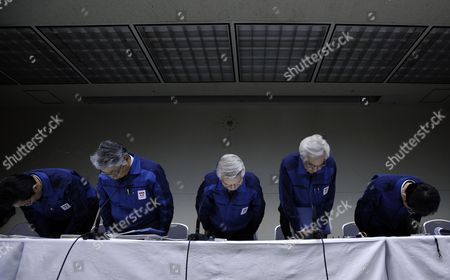 Tokyo Electric Power Co Chairman Tsunehisa Katsumata (c) Bows at the End of a News Conference Held at the Company Headquarters in Tokyo Japan 30 March 2011 Katsumata Said It Will More Than a Few Weeks to Fix the Fukushima Daiichi Nuclear Power Plant Earlier in the Day Tepco Announced That Its President Masataka Shimizu was Hospitalized on 29 March For Hypertension Katsumata is Taking Over Shimizu's Position to Lead Efforts to Control the Crisis Japan Tokyo