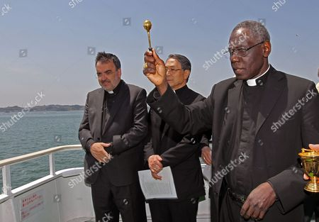 Cardinal Robert Sarah (r) Prays For the Victims of the Earthquake and Tsunami on an Excursion Boat in Matsushima Miyagi Prefecture Japan on 16 May 2011 Sarah is on His Trip to Japan on Behalf of Pope Benedict Xvi to Visit the Earthquake-affected Area in Order to Encourage the Victims Japan Matsushima
