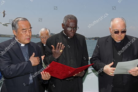 Cardinal Robert Sarah (c) Prays For the Victims of the Earthquake and Tsunami on an Excursion Boat in Matsushima Miyagi Prefecture Japan on 16 May 2011 Sarah is on His Trip to Japan on Behalf of Pope Benedict Xvi to Visit the Earthquake-affected Area in Order to Encourage the Victims Japan Matsushima