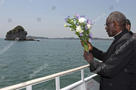 Cardinal Robert Sarah Offers Flowers For the Victims of the Earthquake and Tsunami From an Excursion Boat in Matsushima Miyagi Prefecture Japan on 16 May 2011 Sarah is on His Trip to Japan on Behalf of Pope Benedict Xvi to Visit the Earthquake-affected Area in Order to Encourage the Victims Japan Matsushima
