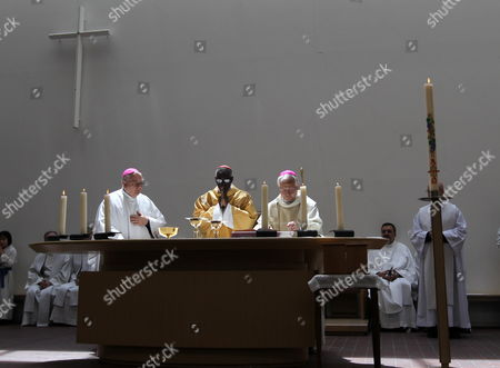 Cardinal Robert Sarah (c) Celebrates a Mass For the Victims of the Earthquake and Tsunami That Hit Northern Japan in March 2011 at the Catholic Mototerakoji Church in Sendai Japan on 15 May 2011 Robert Sarah is in Japan on Behalf of Pope Benedict Xvi to Visit the Earthquake-affected Area in Order to Encourage the Victims Japan Sendai