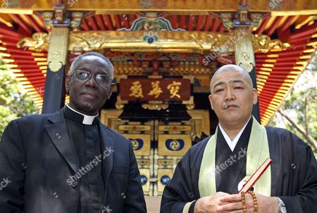 Cardinal Robert Sarah (l) and a Zen Buddhist Priest Pose at Zuiganji Temple in Matsushima Miyagi Prefecture Japan on 16 May 2011 Sarah is on His Trip to Japan on Behalf of Pope Benedict Xvi to Visit the Earthquake-affected Area in Order to Encourage the Victims Japan Matsushima